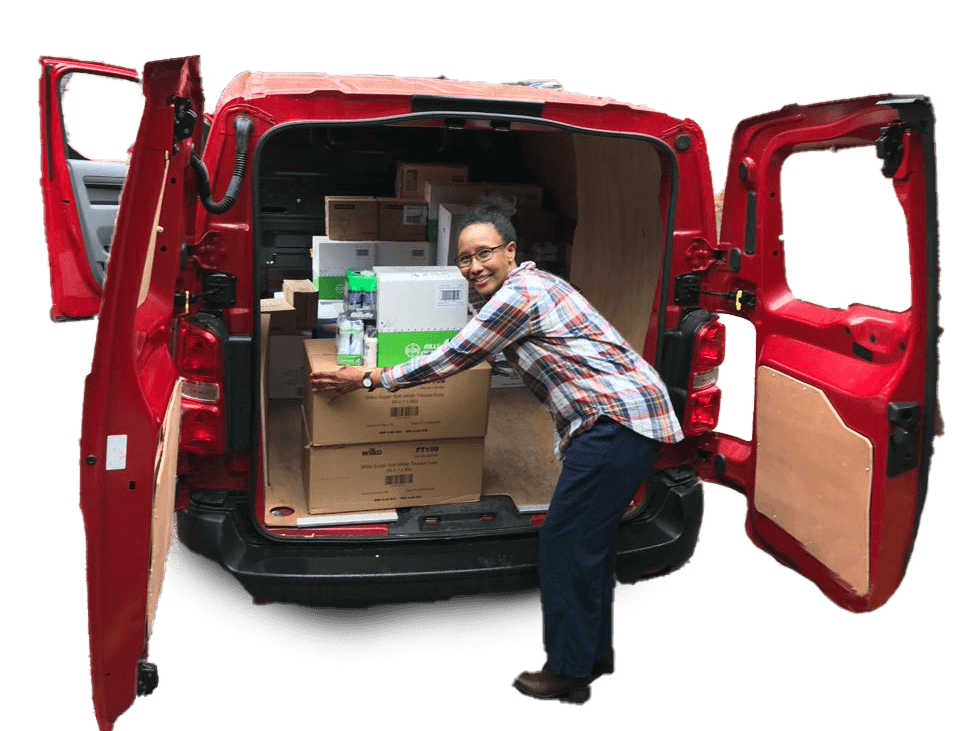 Woman unloading boxes from a red van