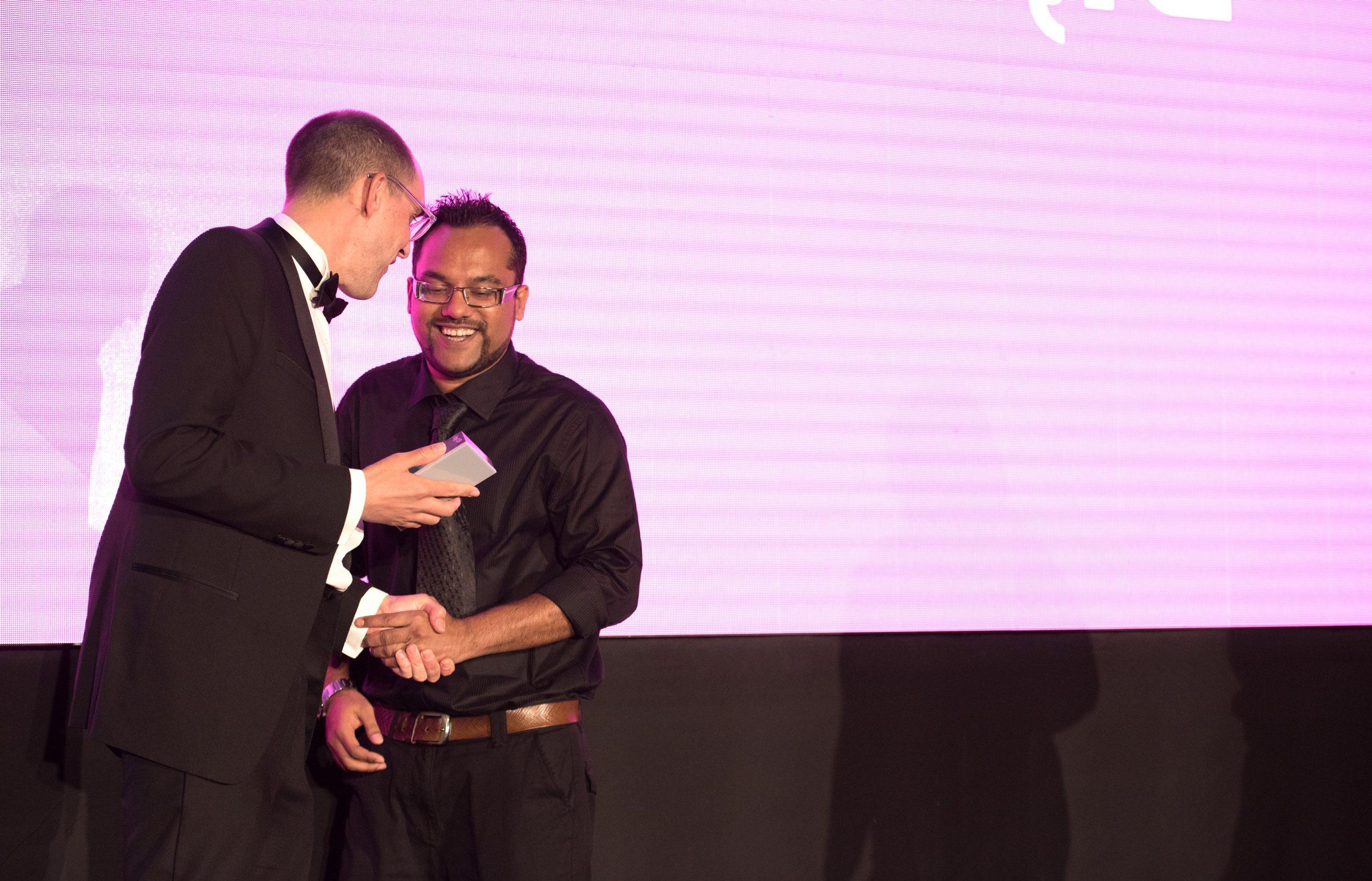 ingenuity partner shaking hands with prize winner