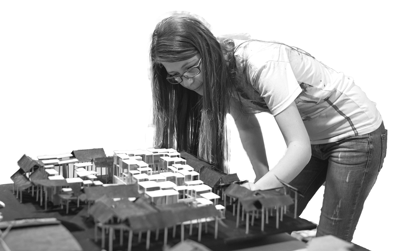 woman building a minature city out of matchsticks